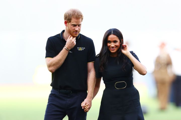 Harry and Meghan look on during the pre-game ceremonies before the MLB London game between the Boston Red Sox and the New York Yankees.