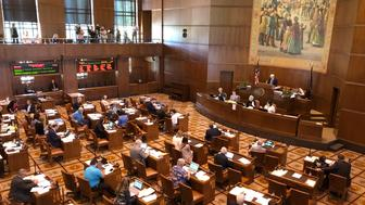 Lawmakers convene at the Oregon Senate after the minority Republicans ended a walkout they had begun on June 20 over a carbon-emissions bill they said would harm their rural constituents, at the Oregon Senate in Salem, Ore., Saturday, June 29, 2019. Nine of the 12 minority Republicans returned after Senate President Peter Courtney said the majority Democrats lacked the votes to pass the legislation aimed at countering climate change.  ( AP Photo/Andrew Selsky)