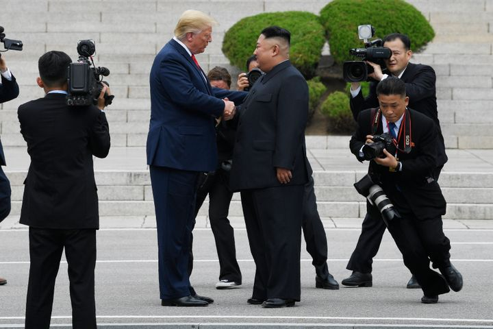 President Donald Trump and dictator Kim Jong Un share a handshake on the North Korean side of the border with South Korea on