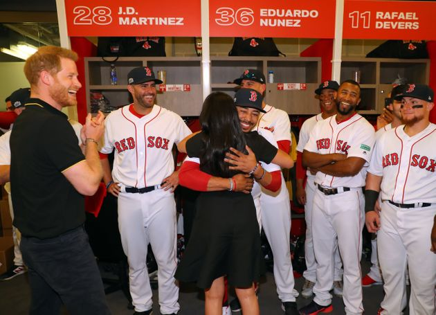 Meghan Markle hugs Mookie Betts at the Yankes-Red Sox game in London on