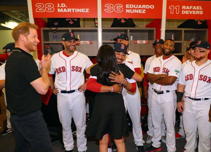 Meghan Markle hugs Mookie Betts at the Yankes-Red Sox game in London on Saturday.
