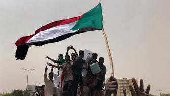 Sudanese protesters shout slogans as they march during a demonstration against the military council, in Khartoum, Sudan, Sunday, June 30, 2019. Tens of thousands of protesters have taken to the streets in Sudan's capital and elsewhere in the country calling for civilian rule nearly three months after the army forced out long-ruling autocrat Omar al-Bashir. The demonstrations came amid a weekslong standoff between the ruling military council and protest leaders. (AP Photo/Hussein Malla)