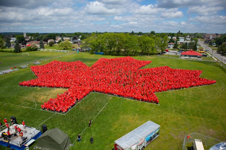 People wear red to form a giant maple leaf in Trenton, Ont. on Saturday.