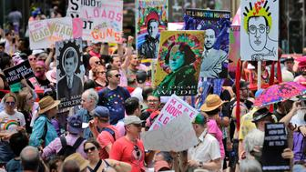 Marchers carry signs with historical LGBTQ figures during the Queer Liberation March in New York, Sunday, June 30, 2019. New York is throwing a massive LGBTQ Pride march as other cities including San Francisco, Chicago and Seattle also host parades commemorating the 50th anniversary of the clash between police and gay bar patrons that sparked the modern gay rights movement.(AP Photo/Seth Wenig)