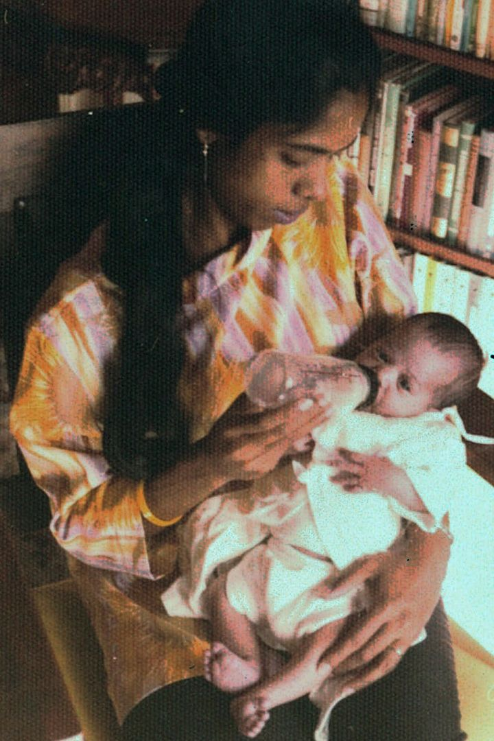 In this undated photo provided by the Kamala Harris campaign in April 2019, Shyamala Gopalan Harris, 25, holds her baby, Kamala.