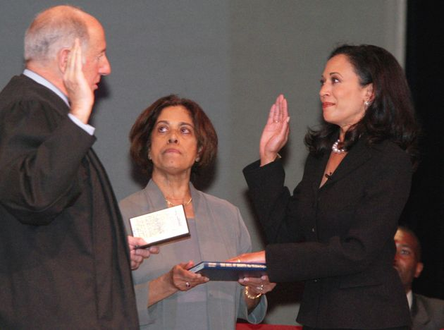 Kamala Harris, right, receives the oath of office on Jan. 8, 2004, in San Francisco. In the center is...