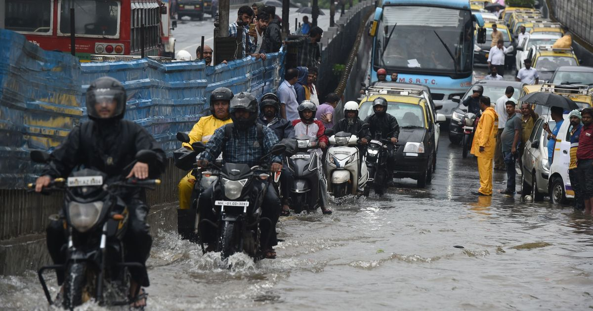 Train Delays And Traffic Jams In Mumbai After Heavy Rains