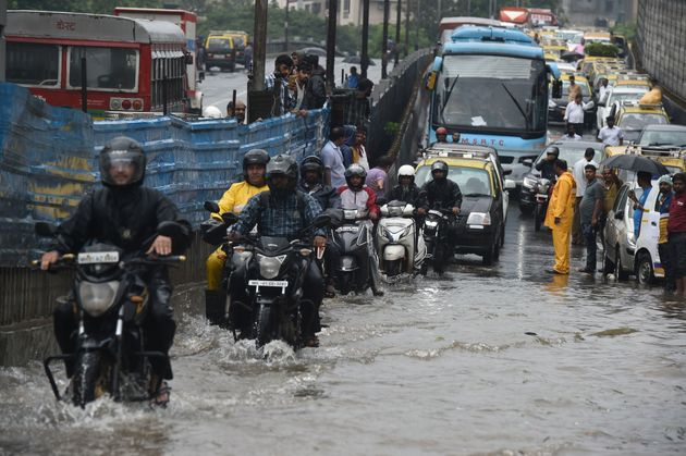 Train Delays And Traffic Jams In Mumbai After Heavy Rains Lash