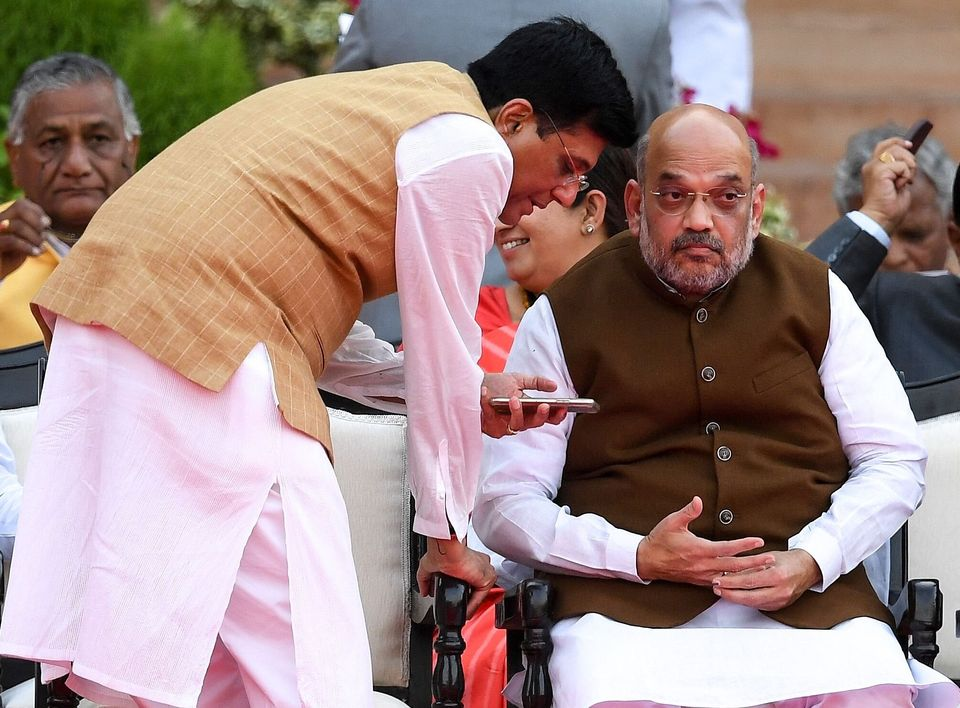 Commerce Minister Piyush Goyal speaking with BJP President Amit Shah in a file