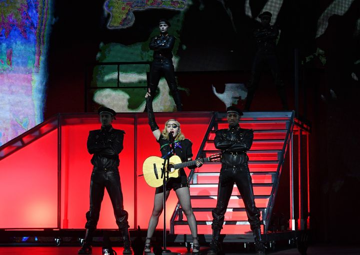 "The Queen of Pop's four-song set included 2003's ""American Life,"" which sparked controversy at the time of its release for it"