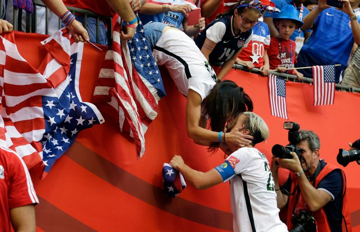 Abby Wambach and Sarah Huffman in 2015.