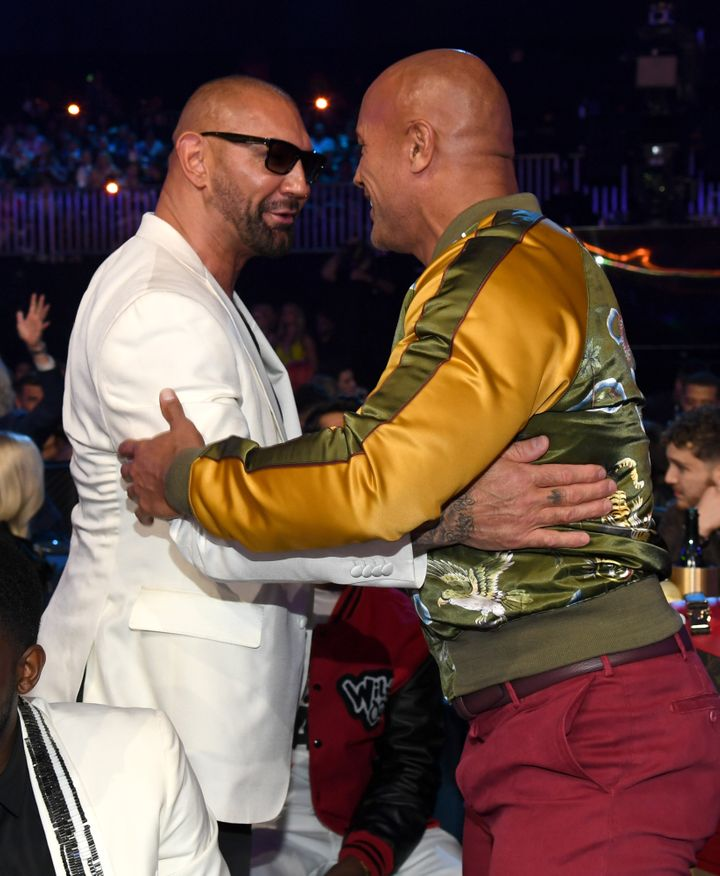 "Dave Bautista and Dwayne ""The Rock"" Johnson attend the 2019 MTV Movie and TV Awards at Barker Hangar on June 15, 2019, in San"