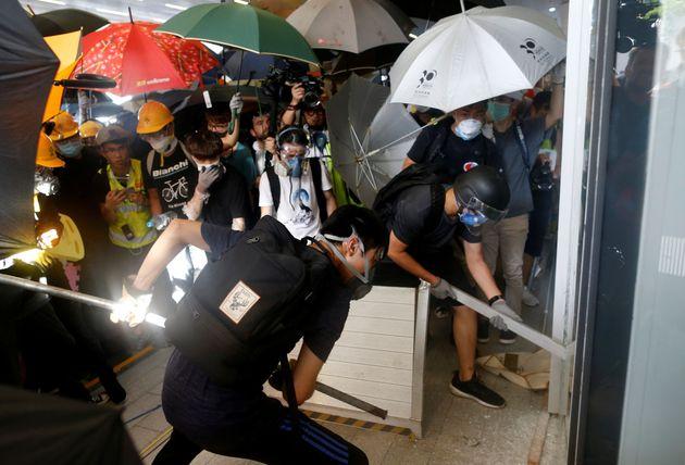 Protestors breaking intothe Legislative Council