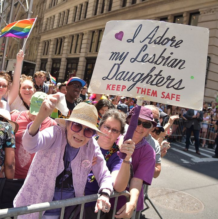 "Frances Goldin, 95, has been attending the Pride march in New York for more than 30 years, holding the same sign, which reads, ""I adore my lesbian daughters. Keep them safe."""