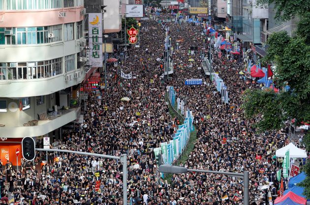 Anti-extradition bill protesters march during the anniversary of Hong Kong's handover to