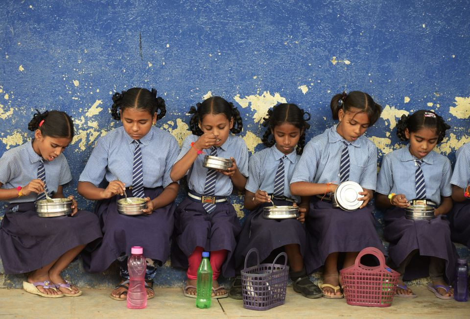 A file photograph of children eating their mid-day