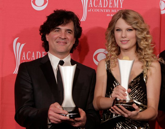 In this April 5, 2009 file photo, producer Scott Borchetta, left, and Swift pose with the Album of the...