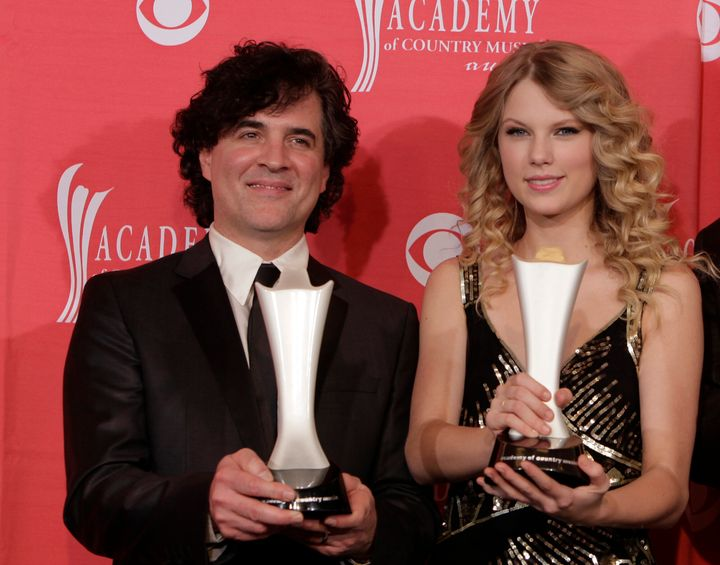 In this April 5, 2009 file photo, producer Scott Borchetta, left, and Swift pose with the Album of the Year award at the 44th