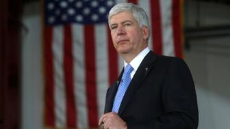Michigan Governor Rick Snyder is seen at a bill signing event in Detroit, Michigan, U.S. on June 20, 2014. Picture taken on June 20, 2014.   REUTERS/Rebecca Cook