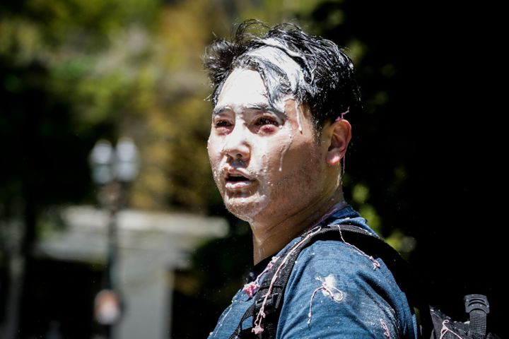 Unidentified individuals bloodied Andy Ngo, a conservative writer at Quillette, and splashed him with a milkshake at a rally hosted by far-right extremists in Portland, Oregon, on Saturday.