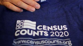 T-shirts are displayed at a community activists and local government leaders event to mark the one-year-out launch of the 2020 Census efforts in Boston, Massachusetts, U.S., April 1, 2019.   REUTERS/Brian Snyder