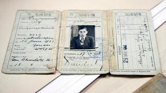 The travel document of Joseph Stripounsky, who was 17 when he fled Belgium with his family, is shown at the Holocaust Memorial Museum in Washington, Wednesday, June 7, 2017. The U.S. Holocaust Memorial Museum is launching its first-ever crowd-funding campaign in an effort to preserve and digitize more than 200 diaries from Holocaust victims and survivors. (AP Photo/Manuel Balce Ceneta)