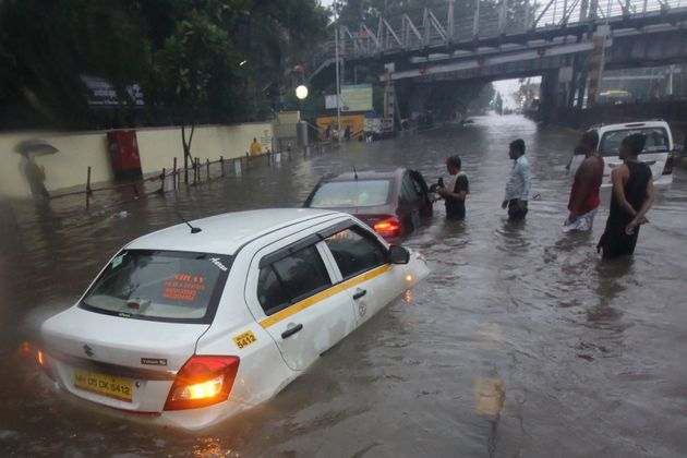 A taxi is seen stuck at a waterlogged street during heavy rains in Mumbai, on 1 July