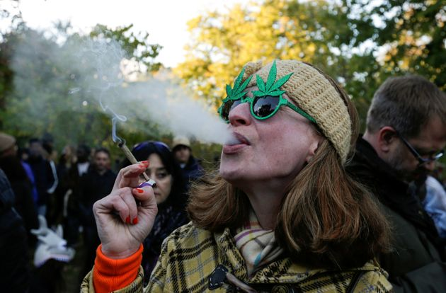 A woman smokes marijuana at a Toronto park after cannabis became legal in