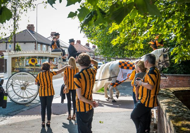 Mourners dressed as super heroes and in football shirts attended Stanley's