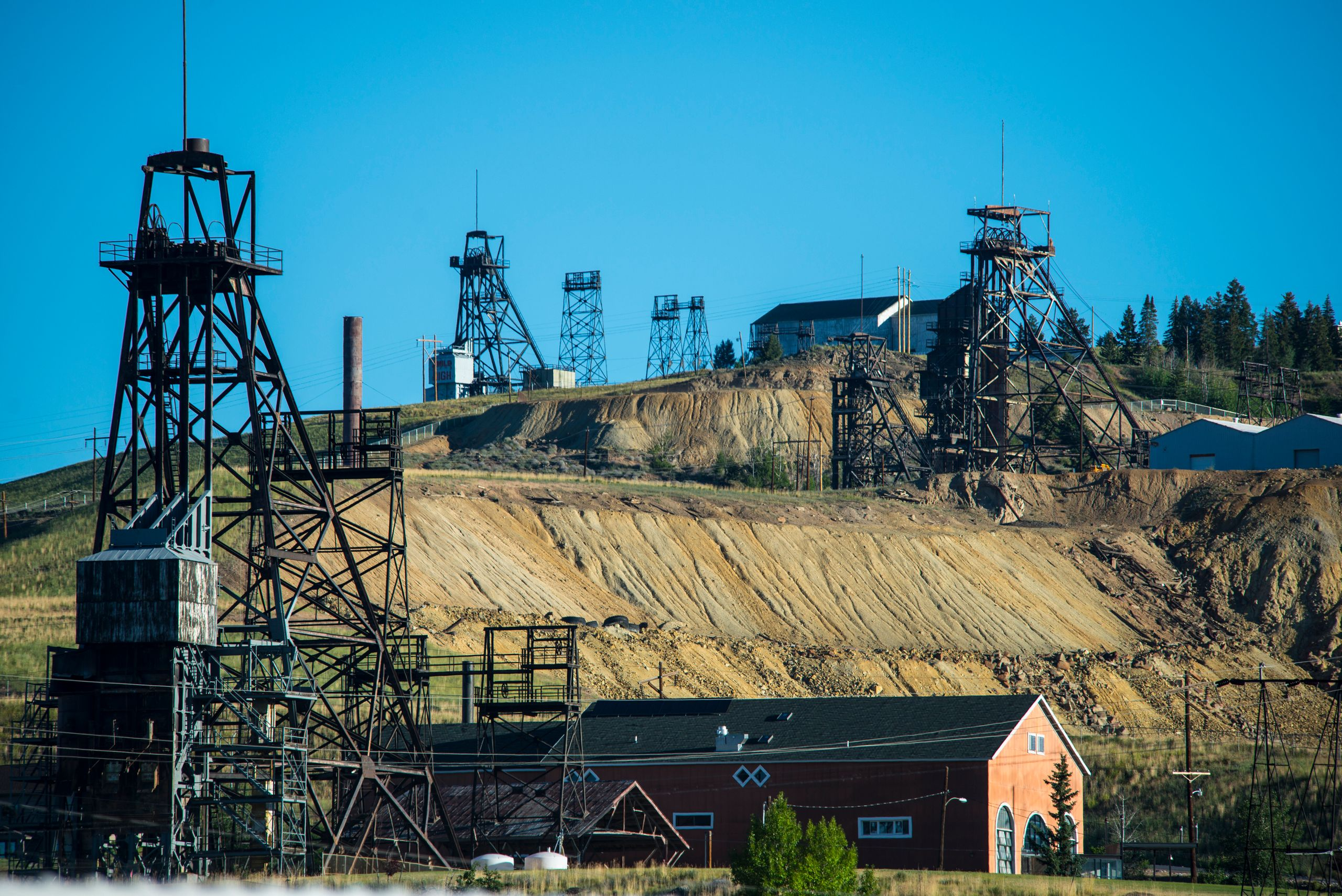Old copper mine shaft headframes on a hill above Butte, Montana.