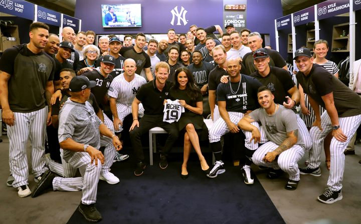 The Duke and Duchess of Sussex join the New York Yankees in their clubhouse ahead of their game against the Boston Red Sox at the London Stadium on June 29 in London.