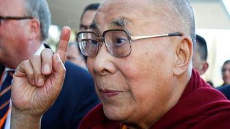 Tibetan spiritual leader the Dalai Lama gestures as he arrives at a hotel in Darmstadt, Germany, September 18, 2018. REUTERS/Ralph Orlowski
