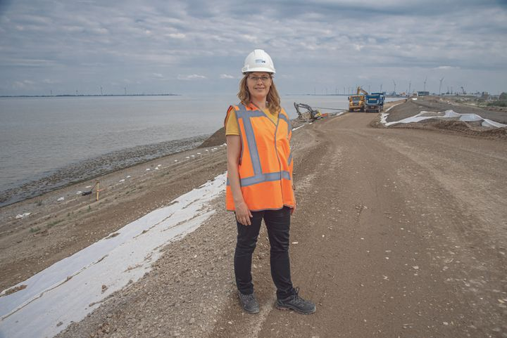 <em>Silvia Mosterd standing on the dike near Delfzijl. Mosterd works for one of the 21 regional Dutch water boards, which for