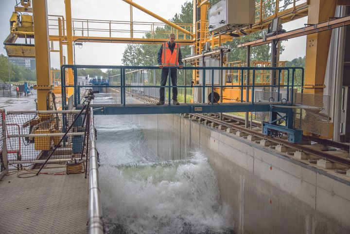 <em>A researcher at the The Deltares Research Institute in Delft runs a test in the Delta Flume, a 300 meter-long wave machin