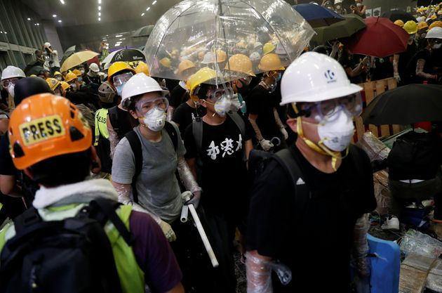 Anti-extradition bill protesters wearing helmets gather outside the Legislative Council building on the...