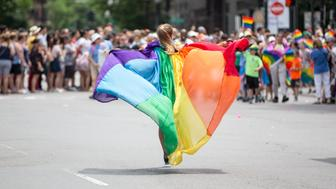 BOSTON, MA - JUNE 09:  A woman wearing a pride flag runs down Charles St. during the 2018 Boston Pride Parade passes on Clarendon St. on June 9, 2018 in Boston, Massachusetts. (Photo by Scott Eisen/Getty Images)