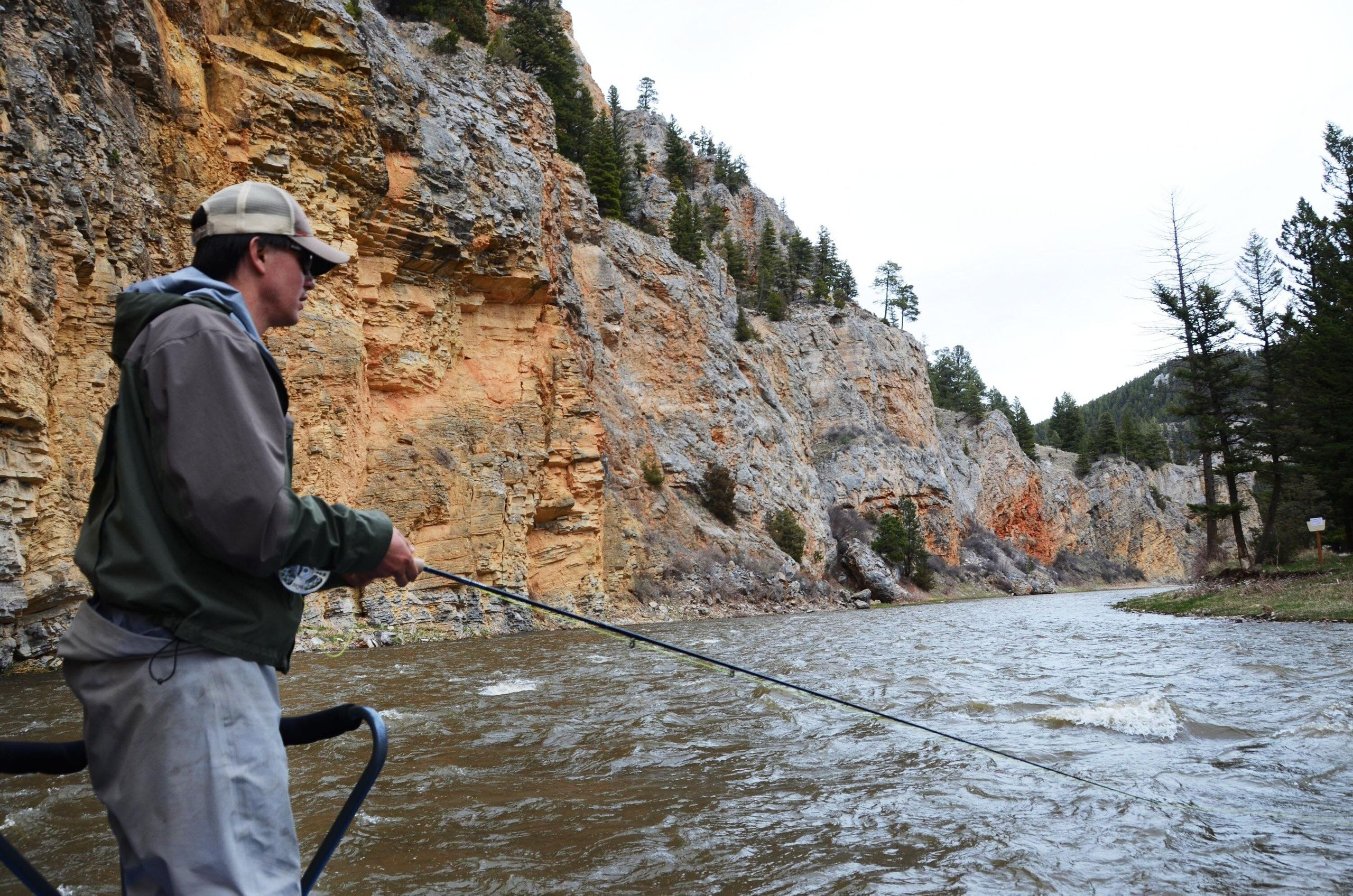 An angler fishes for trout along the scenic Smith River.