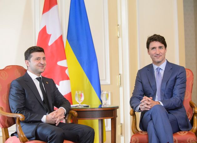 Ukrainian President Volodymyr Zelenskiy and Prime Minister Justin Trudeau sit together at the Hotel Fairmont...