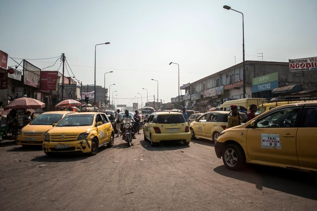 Yellow taxis clog up the streets of Kinshasa, capital of Democratic Republic of Congo. Sub-Saharan Africa...