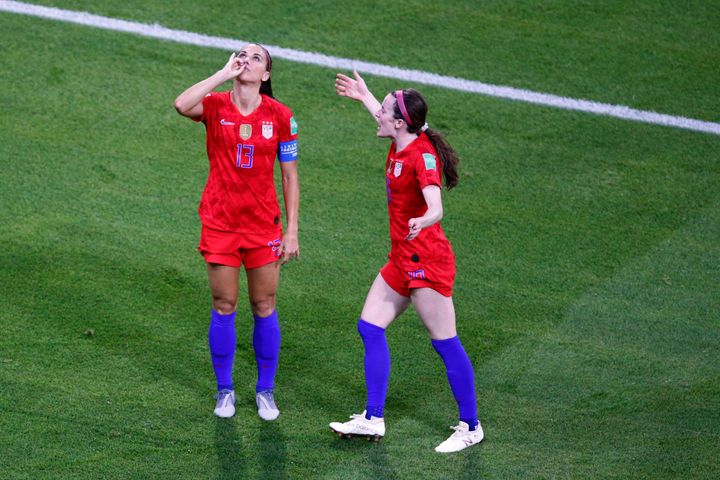 Alex Morgan celebrates after scoring a goal against England in the FIFA Women's World Cup.