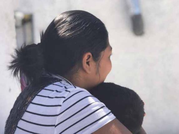 """""""Carmen S."""" holds her son, 3, at a shelter where they were staying in Ciudad Juárez,..."""