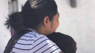 """Carmen S."" holds her son, 3, at a shelter where they were staying in Ciudad Juárez, Mexico, May 2019, after being returned to Mexico under the Trump administration's ""Migrant Protection Protocols."" Carmen told Human Rights Watch that she was thinking of trying to cross illegally but was afraid of losing her children."
