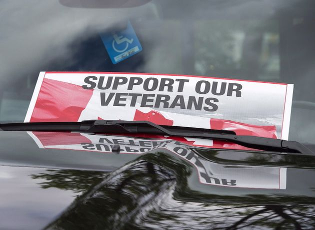 A sign is placed on a truck during a Banished Veterans protest outside the Veterans Affairs office in...
