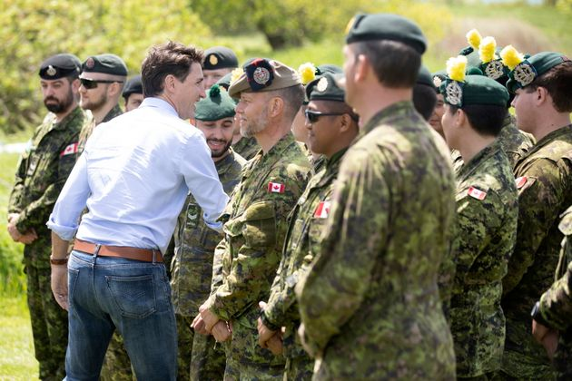 Prime Minister Justin Trudeau greets the Canadian Armed Forces at a veterans in Whitby, Ont. on...