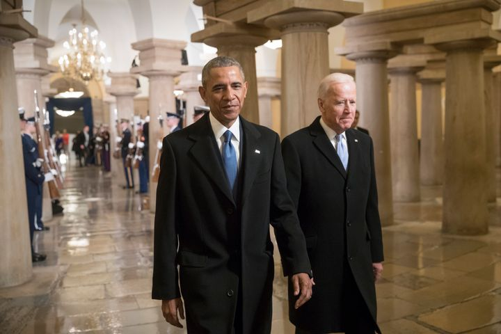 Obama and then-Vice President Joe Biden walk through the Capitol on their way to attend Donald Trump's inauguration ceremony