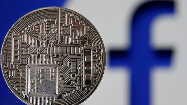 "PARIS, FRANCE - JUNE 24:In this photo illustration, a visual representation of a digital cryptocurrency coin sits on display in front of a Facebook logo on June 24, 2019 in Paris, France. Since the announcement of its creation a few days ago, the virtual currency of Facebook Libra fascinates as much as it worries. Thus, a few days after the announcement of the arrival of the social network in the sector, the Bank for International Settlements (BIS) considers that the incursion of major technologies into financial activity presents ""new and complex compromises between financial stability , competition and data protection "".(Photo by Chesnot/Getty Images)"
