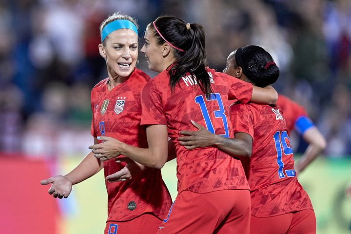 Morgan celebrates with Ertz and Crystal Dunn after scoring her 100th international goal in game action during an friendly match between the United States and Australia on April 4, 2019, in Commerce City, Colorado.