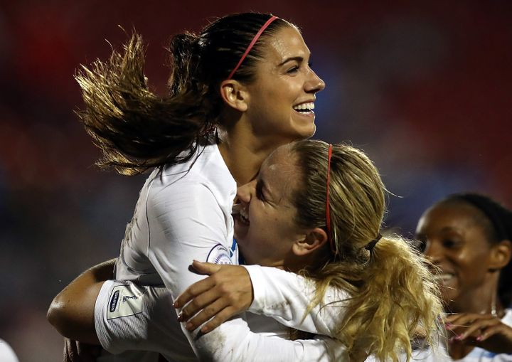 Alex Morgan and Lindsey Horan celebrate at a match against Canada during the CONCACAF Women's Championship final match on October 17, 2018, in Frisco, Texas.