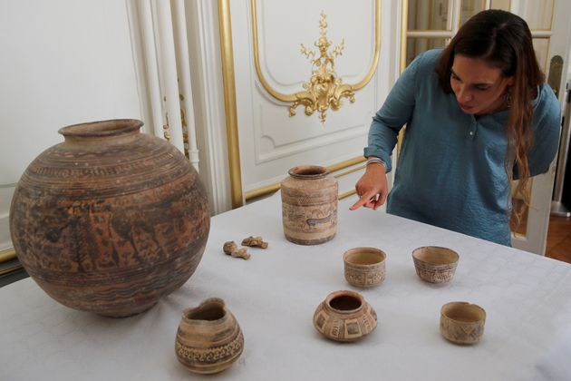Archaeologist Aurore Didier points to some artefacts amongst the 445 artefacts from the 2nd and 3rd millennium...