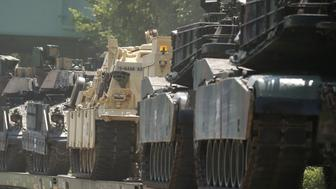 M1 Abrams tanks and other armored vehicles sit atop flat cars in a rail yard after U.S. President Donald Trump said tanks and other military hardware would be part of Fourth of July displays of military prowess in Washington, U.S., July 2, 2019. REUTERS/Leah Millis     TPX IMAGES OF THE DAY